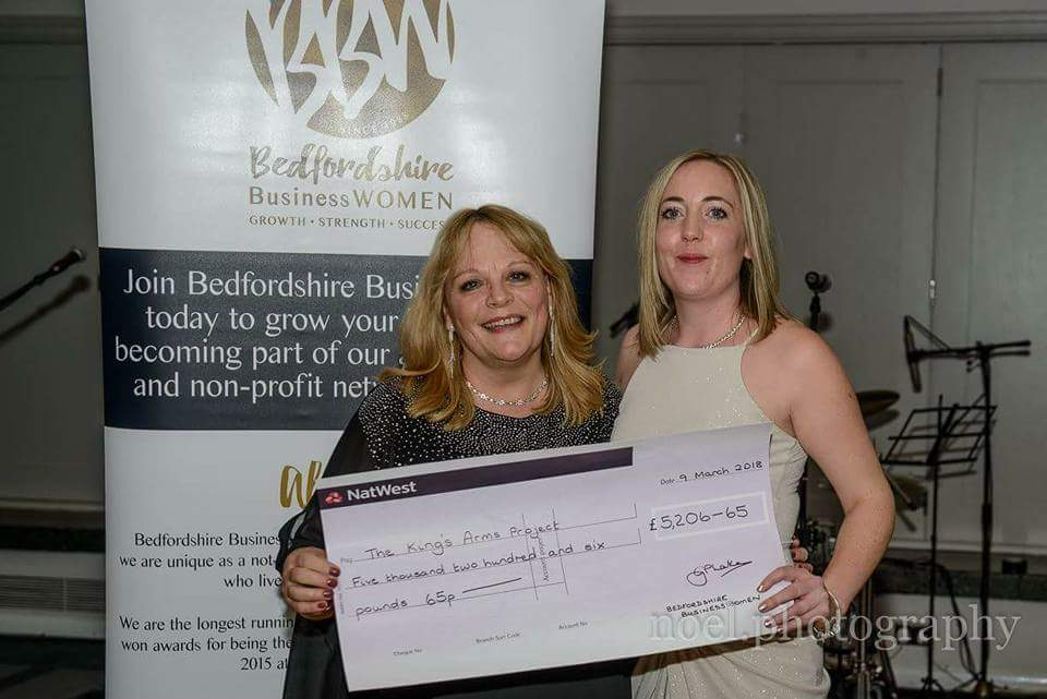 Philomena presenting a cheque for over £5,000 to The Kings Arms Project
