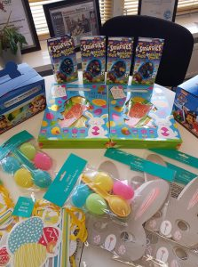 Easter egg hunt packs passed on to families at the YMCA Women's refugee in Bedford