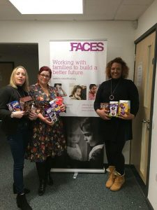 Members of the Watton team pass Easter eggs on to FACES